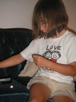 Alyssa making a necklace.
