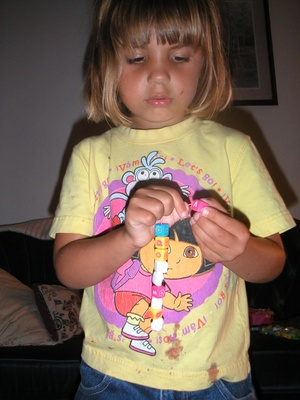 Emily's necklace is made of many different type of beads.
